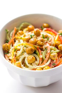a SUPER SIMPLE quinoa salad made with spiralized veggies and crispy chickpeas (topped with an almond butter dressing!)