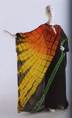 """Evening Dress,"" Halston, 1975, Silk chiffon tie-dyed in orange to yellow ombre grid pattern with green diagonal stripe; Brooklyn Museum Costume Collection at The Metropolitan Museum of Art, Gift of the Brooklyn Museum, 2009; Gift of Carol Siris Roaman, 1983, photo from catalogue"
