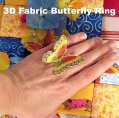 3D butterfly ring made with printed fabric, Steam-a-Seam Lite 2, and 22 gauge copper wire,adding a tiny bit of batting between the front and back of the butterfly