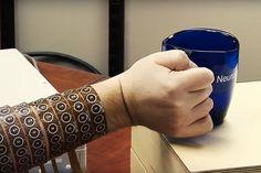 A brain implant brings a quadriplegic's arm back to life.