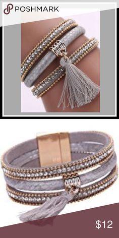 Multi layer leather rhinestone tassel bracelet Stylish 3 layer leather and rhinestone bracelet with tassel gold magnetic clasp closure .Love this bracelet Jewelry Bracelets