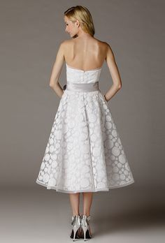 Brides: Aria. Vintage inspired strapless tea-length dress in lace. Made in USA