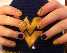 Let's go.........Mountaineers!!!                              Get your WVU manicure at www.jessiewilson.jamberrynails.net