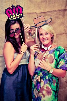 Photo booth props made from flat images on sticks...
