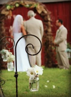 That arch and the daisy aisle markers are to die for! Click the image to learn more about the fabulous floral creations by Flowers by Tammy! Photo credit: Flowers By Tammy