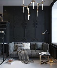 Des boiseries peintes en total look noir pour donner du chic au salon.