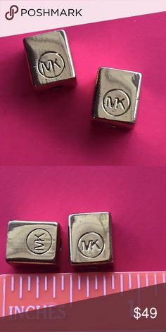 """2 Authentic Michael Kors jewlery Beads !!! This is a set of 2 authentic Michael Kors logo rectangle jewelry beads. Both are gold tone and measure approximately 0.25"""" x 0.25"""" x 5/16 of an inch. Both beads are in excellent condition and authentic. See photos for details. Michael Kors Jewelry Bracelets"""
