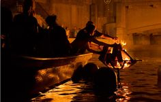 Volunteers stoke the fires. WaterFire Providence #lovewaterfire @WaterFire Providence