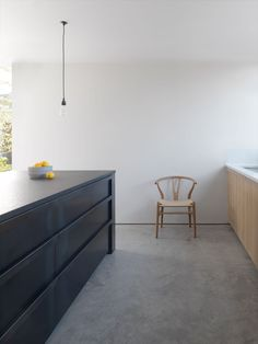 Dark & deep drawers in the kitchen above heated concrete floors