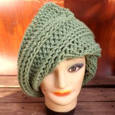 Celebrate the women's crochet JUDY Möbius strip beanie hat. The 3in(7.5cm) extra wide flap compliments the rest of hat to shape like a rain drop. It flows beautifully within itself. Tuck in or untuck the top. You still get the same comfort in a loose fit. Tuck in or untuck the left flap.