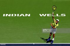 Kei Nishikori of Japan serves to Feliciano Lopez of Spain during day ten of the…