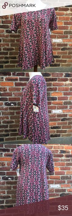 NWT Lularoe Perfect T Sz Medium Floral Print Never worn with tags Lularoe Perfect T size medium. Pretty floral pattern with slits up each side of the shirt. Lularoe shirts can be styled in many ways; wear it under a denims jacket with a skirt or pair it with a wide belt and some leggings. Either way this is a must have item in your closet. LuLaRoe Tops Tees - Short Sleeve