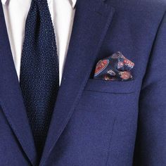 The classic paisley design lends itself well to a pocket square. The popular combination of navy and red is enhanced with tones of blue and ochre.