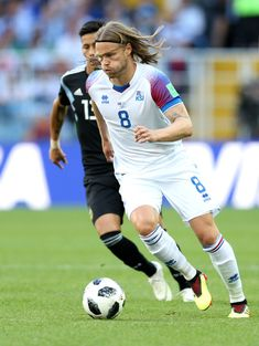 Birkir Bjarnason of Iceland is challenged by Maximiliano Meza of Argentina during the 2018 FIFA World Cup Russia group D match between Argentina and Iceland at Spartak Stadium on June 2018 in Moscow, Russia. Bristol City, Aston Villa, Fifa World Cup, Football Players, June 16, Moscow Russia, Running, Goku, Athletes