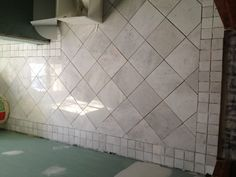Redoing bathroom floor tiles.