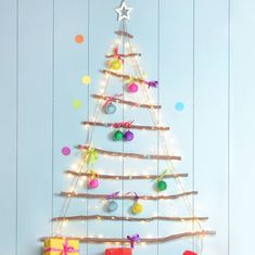 If space is tight or you just fancy something orignal this year our Rope Ladder Hanging Christmas Tree is just the thing !It is made from real birch branches, we love it decorated with Bright Baubles for a fun and festive look for Christmas 2017The rope and rustic branches also give the tree a rustic feel,and will look equally beautiful if hung with traditional baubles and fairy lights.Please add the pom poms or white LED lights from the drop down menu if required woodHeight: 158cmTop Branch Christmas Trees Uk, Ladder Christmas Tree, Christmas Room, Xmas Tree, Christmas Lights, Christmas Decorations, Christmas Ornaments, Holiday Decorating, Christmas Crafts