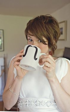 love the hair and the mug.