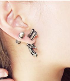 ROWKY retro pistol bullet earrings.