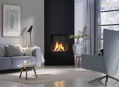 Gas fireplace / contemporary / closed hearth / built-in TRIMLINE ThermoCet BV Corner Gas Fireplace, Bedroom Fireplace, Home Fireplace, Fireplace Inserts, Modern Fireplace, Living Room With Fireplace, Fireplace Design, Living Room Decor, Corner Stove