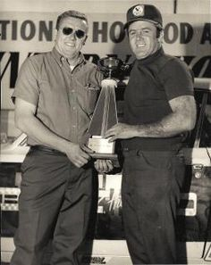 Herb McCandless (Mr. 4 Speed) and Bill Stepp.  Herb was one of many drivers who drove the Billy the Kid cars.  This photos was taken at the Winner's Circle at The 1st Gatornationals in 1970, Modified Eliminator.