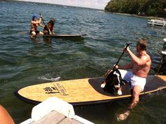 Steven Stamkos and Steve Downie paddleboarding with their dogs, Magnum and Trigger