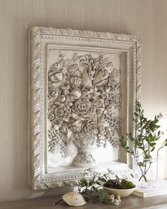 """French Bouquet"" Wall Art at Horchow.  Handcrafted French reproduction wall decor features a relief of a bouquet of flowers spilling from a vase. A dimensional frame adds depth to the already larger-than-life piece, making it ideal for use in a larger space. The entire piece is hand painted in an antique-white finish. Includes two hooks in back for hanging. 28""W x 3""D x 33""T. Imported."