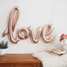 """No one loves you like I do. Now I can prove it with this fun """"love"""" script balloon. Perfect for a bridal shower, Valentines Day or just decorate your room with something you love. > Made of Rose gold"""