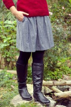 red sweater grey dress/skirt black boots