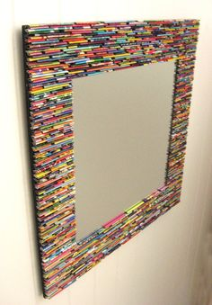 framed mirror, made from recycled magazines (I remember something very similar to this when I was a kid.  Wed roll magazine pages tight and glue them to a clean, empty ice cream bucket - the big 5 gal. ones from the ice cream shop.  Up-cycled trash can!)