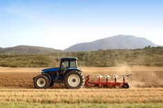 Image result for wheat and tractor