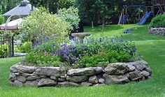 "Natural Stone raised bed:  ""This raised bed is edged with irregular sized granite."""