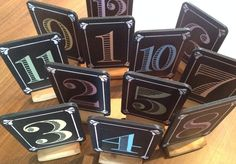 12 handmade blackboard pastel coloured table numbers