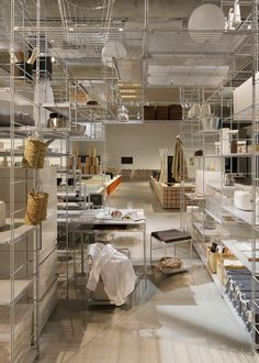 Fumihiko Sano used Japanese design brand Muji's popular steel shelving system to create this room-like installation