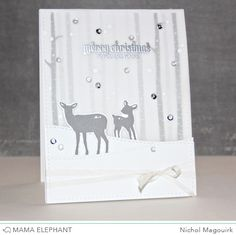 Mama Elephant Winter Wonderland stamp set.  Mama Elephant Peek A Frame,  Landscape Trio and Winter Wonderland dies.  Inks:  Simon Says Stamp Fog, Smoke and Slate.