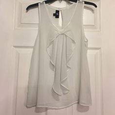 SOLD IN BUNDLE! Top with a bow on the front! Never worn, only washed once! Size medium. *****all $8 items in my closet are $8 for 1, $13 for 2, and $16 for 3! Tops