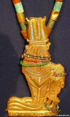 Pendant representing Renenutet nursing king Tutankhamun, strung on a beaded necklace. 18th dynasty. Cairo Egyptian museum.