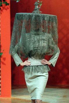 """McQueen design for Givenchy with huge hat (AKA """"Excuse me, but that is my coffee table you are wearing on your head""""."""