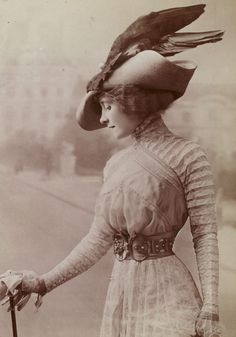 1900s That woman has an entire bird on her head!
