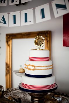 A nautical-inspired vintage wedding cake by Cloudberry Bakery. Photo by Brosnan Photographic