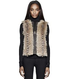 Isadora Fur Vest  Directly from Tory Burch - One of our style musts for chillier days, our Isadora Vest is made from leather-trimmed coyote for a uniquely luxurious look and feel. This versatile piece can instantly transform any look, from adding some polish to more laid-back outfits - think jeans and long-sleeve t-shirts - to lending a downtown vibe to fall's ladylike dresses, while keeping you perfectly toasty and chic. Tory Burch Official Site.