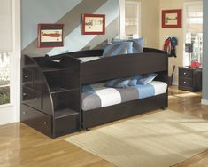 Twin loft bunk bed with twin trundle/2 mattresses. Dark merlot finish. Stairs on left with storage drawers.