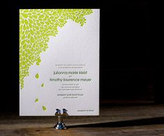 Dewdrop is a modern and funky letterpress wedding invitation style boasting a spray of botanical petals and clean contemporary lines.