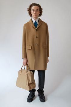 Acne Studios Matthew camel beige is a tailored, three button single breasted coat with double face construction.