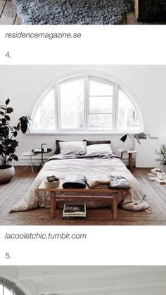 bed set up. simple. clean. round side tables. plants. low foot table. beautiful window :)