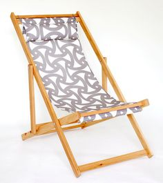 Trina Turk Geometric gray and white outdoor fabric on white oak deck chair
