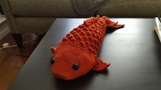 This pattern makes a large (2ft), realistic but charming Koi fish. It has a satisfying scaly texture and flowing tail. It is worked in-the-round, in Crocodile Stitch. The fins are worked directly onto the fish and the head is made separately and attached.