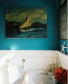Teal wall and white wainscoting