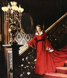 Red Robe Dress- This dress was worn during the scene after Ashely's Birthday Party and the classic stair scene where Rhett Butler picks Scarlett up and takes her upstairs to ravish her