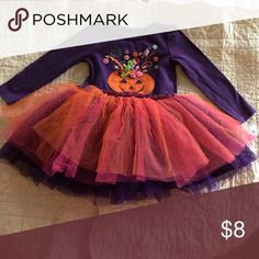 Marmellata girls 2T dress. Gently used. Lovely Marmellata Halloween inspired dress in size 2T. Gently used. Long sleeved. Top is purple and there is slight fading. 3D pumpkin appliqué. Intricate detailing. Skirt of dress is 4 layers. Orange, pink, and purple tulle followed by final purple underlayer. Skirt is fluffy and full. Top is cotton and spandex and skirt is polyester. Machine wash gentle cycle. No stains or tears. Only sign of use is slight fading of purple top of dress as previously…