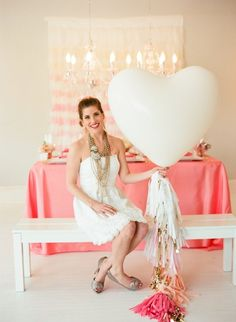 Who will not LOVE this gigantic balloons decorated with garland tassels in shades of pink with white and gold? Any bride-to-be will be excited to do this on her bridal shower! this is such a cute and adorable way to decorate a bridal shower party
